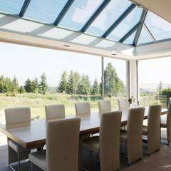 Jardines de invierno de estilo minimalista por KELLER AG