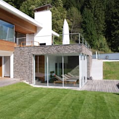 Villa in stile  di Firmhofer + Günther Architekten
