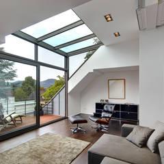 Dachgeschoss Mit Glasgaube: Wohnzimmer Von Architekturbüro Lehnen