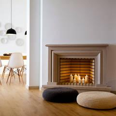 Living room floor: Paredes  por Home Staging Factory