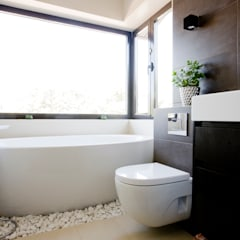 Lecho de piedras : Baños de estilo  de IPUNTO INTERIORISMO