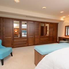 Mr & Mrs Swan's Bespoke Walnut Bedroom: classic Bedroom by Room
