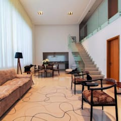 Residência Unifamiliar Condomínio Alphaville Londrina 2:  Living room by Tony Santos Arquitetura