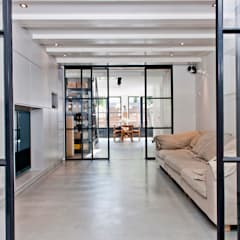 Industrial style media room by Kodde Architecten bna Industrial