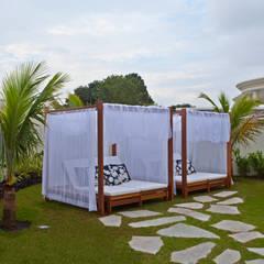 Casa Chelsea: Jardins  por Designer de Interiores e Paisagista Iara Kílaris