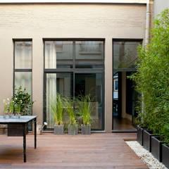 LOFT PARISIEN: Jardin d'hiver de style  par ID CHRISTOPHE DAUDRE