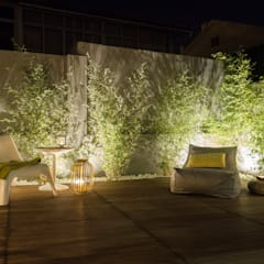 Garden by MUDA Home Design,