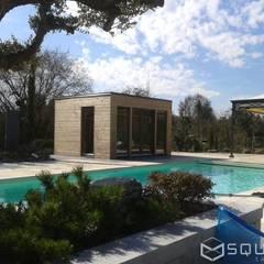 Saunahaus SQUARE XL als Poolhaus mit Sauna - Fassade: Lärchenholz-Rhombusprofil :  Spa von SQUARE Saunahaus