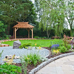 "A view across the garden to the ""tea house"" inspired seating area:  Garden by Lush Garden Design"
