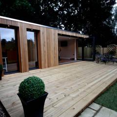 Garden treatment room and gymnasium:  Garden by The Swift Organisation Ltd
