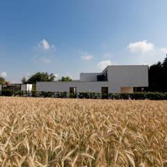 Woning VAWE:  Tuin door areal architecten cvba