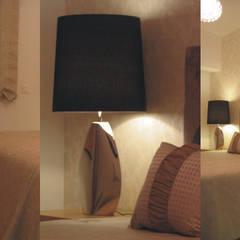 Suite principal: Quartos  por Traço Magenta - Design de Interiores