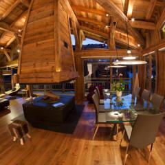 Chalet Les Chantéls: salle à manger et cheminée: Salle à manger de style de stile Rural par shep&kyles design