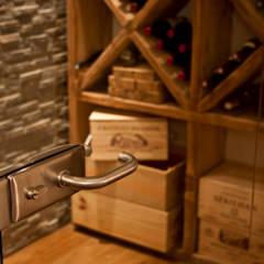 Chalet Les Chantéls: cave à vin: Cave à vin de style de stile Rural par shep&kyles design
