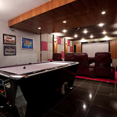 The Cliff - Jersey:  Media room by Nethaus Ltd,