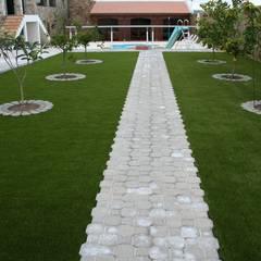 Césped Artificial: Jardines de estilo  de Ceramistas s.a.u.