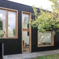 JEUX : Maisons de style  par bertin bichet architectes
