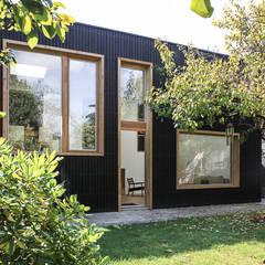 TRANCHE: Maisons de style  par bertin bichet architectes