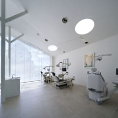 Hospitales de estilo  por eleven nine interior design office