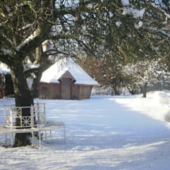 A 10m² barbecue cabin at the bottom of a snowy cabin in Scotland. :  Garden by Arctic Cabins