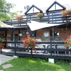 Pensjonat Lecą Żurawie koło Połczyna Zdroju: styl , w kategorii Hotele zaprojektowany przez Studio Projektowe RoRO interior + design