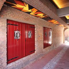 Doorgang:  Winkelruimten door  Ariens cs, Architecten & Ingenieurs