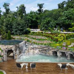 Taras połączony z grotą skalną i basenem: styl , w kategorii Taras zaprojektowany przez Twoje Miejsce
