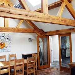 Oak Timber Frame House Extension, Gatley, Cheshire, Manchester:  Dining room by Grant Erskine Architects