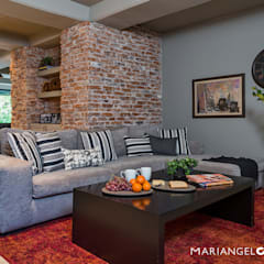 Media room by MARIANGEL COGHLAN,
