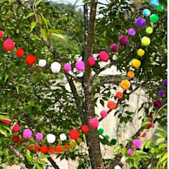 Pom Pom Garlands in the Garden : eclectic Garden by PomPom Galore