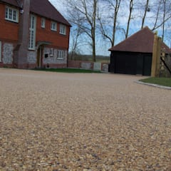 Domestic Driveways installation of resin bound paving:  Walls by Permeable Paving Solutions UK