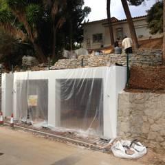 CONSTRUCCIÓN PARKING DE 2 VEHÍCULOS: Garajes de estilo  de Rudeco Construcciones