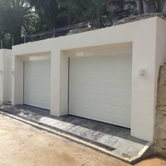 CONSTRUCCIÓN PARKING DE 2 VEHÍCULOS: Garajes dobles de estilo  de Rudeco Construcciones