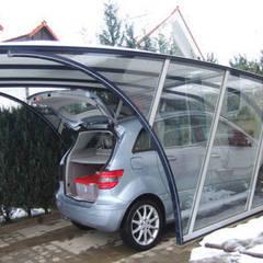 Garajes de estilo  por FRANCE ABRIS : Spécialiste  abri de jardin, garage, carport, Moderno
