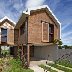 ECOLOGIA: Maisons de style de style Tropical par T&T architecture