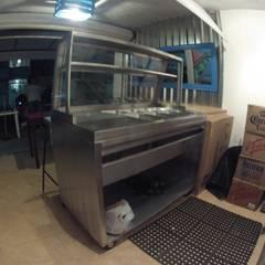 cocina: Restaurantes de estilo  por Armatoste studio