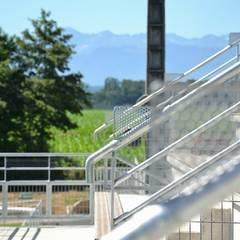 Stade de rugby: Stades de style  par AeA - Architecture Eric Agro