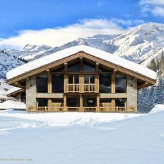 Alpine Holzhaus Chalet Schweiz: rustikale Häuser von Finnscania Blockhausfabrik