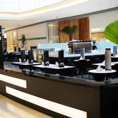 Press Café Barra Shopping: Espaços gastronômicos  por Tellini Vontobel Arquitetura