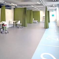 nach dem Umbau: industrialer Fitnessraum von Füglistaller Architekten AG