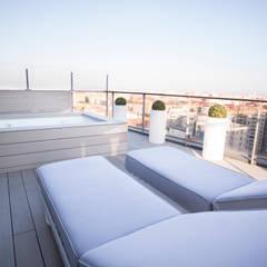 Como decorar mi casa para ganar luz: Terrazas de estilo  de Estatiba construcción, decoración y reformas en  Ibiza y Valencia