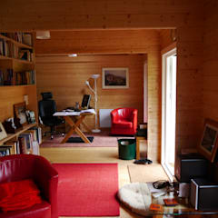 Log cabin garden room interior:  Garden by Garden Affairs Ltd