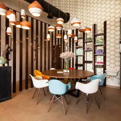 Espacios comerciales de estilo  por Dominique Herbillon & Edouard Augustin