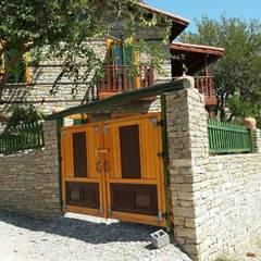 Kayalar İnşaat Ltd şti.  – Doğal taş ev ve doğal taşlar ile bahçe duvarı:  tarz Evler