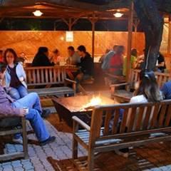 OLYMPOS ORANGE BUNGALOWS – CAMP FIRE: rustik tarz tarz Kış Bahçesi