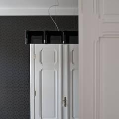Projekt kancelarii prawnej w Poznaniu.: styl , w kategorii Przestrzenie biurowe i magazynowe zaprojektowany przez Konrad Idaszewski Architekt