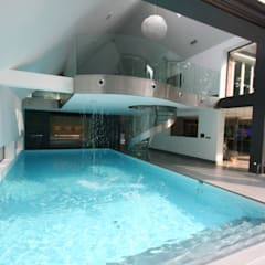 Indoor  pool with waterfall features, sauna and stainless steel spa:  Pool by Tanby Swimming Pools
