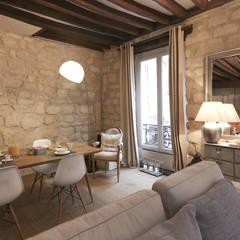 Décoration d'un appartement ancien: Salon de style  par Xavier Lemoine Architecture d'Intérieur,
