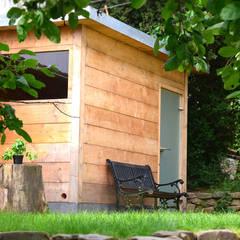 Garage/shed by sophisticated architecture Fietzek von Dreusche Partnerschaft GmbB