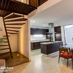 Vestíbulo: Pasillos y recibidores de estilo  por Grupo Arquidecture